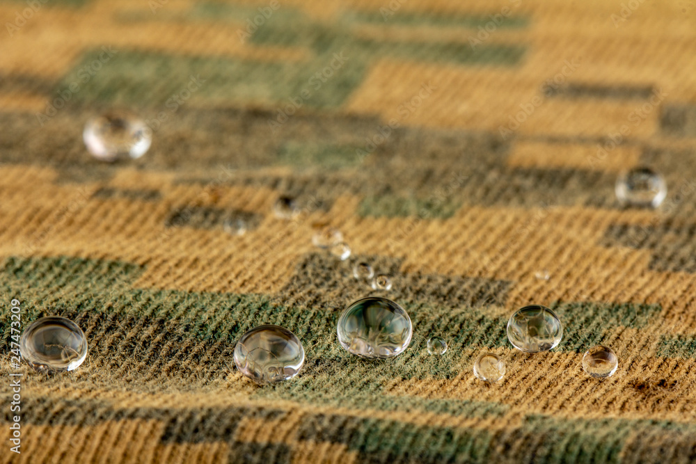Fototapeta Water droplets on moisture resistant fabric Close up