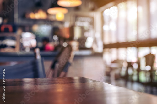 Wooden table with blurred background in cafe Wallpaper Mural