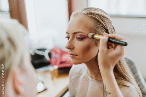 Photo  Model getting her makeup done
