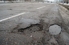 Poor Condition Of The Road Surface. Winter Season. Wet And Foggy Weather. Residential Area Of Kiev.