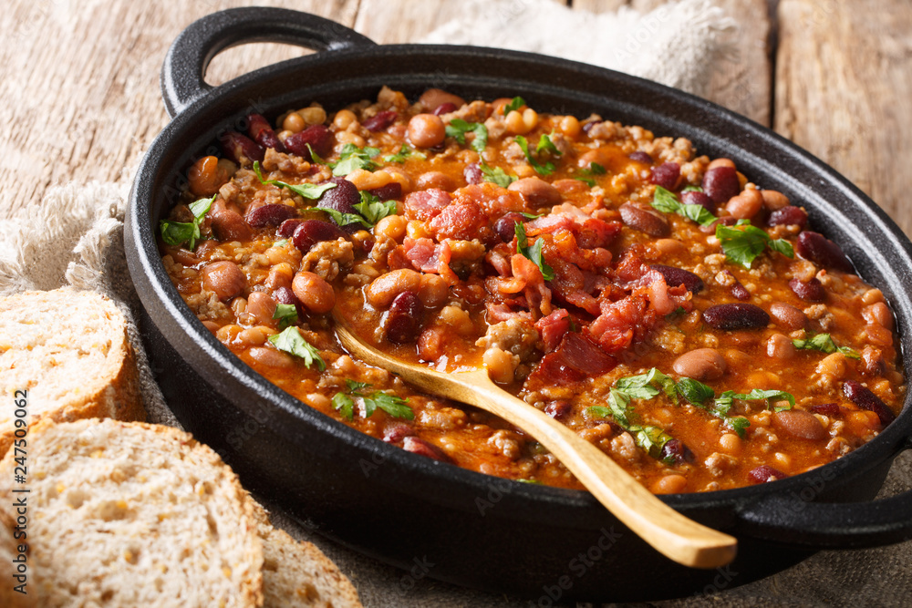 Fototapety, obrazy: Crock pot beans with ground beef, bacon in a spicy sauce closeup on the table. horizontal