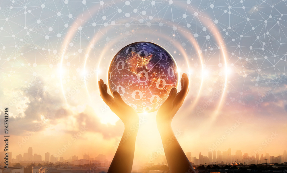 Fototapeta Hands holding earth and wave circle global structure network connection and data exchanges customers worldwide on sunset background. Innovation and inspiration. Networking and technology concept
