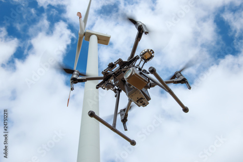 Obraz Industrial drone for inspection of rotor blades on wind turbines - fototapety do salonu