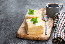 Napoleon Cake Slices With Cup Of Coffee On Gray Table