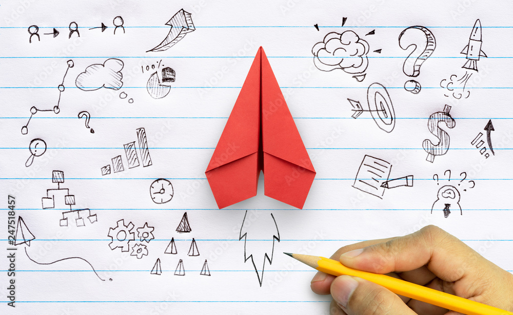 Fototapeta Business success, innovation and solution concept, Red paper plane and business strategy with hand drawing on notebook