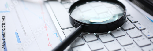 Photographie  Magnifying glass lies on white keyboard