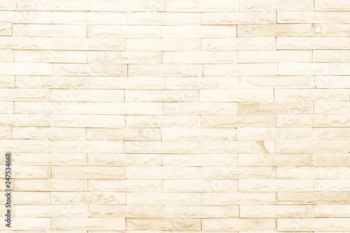 Photo  Seamless Natural pattern of decorative brick sandstone wall.