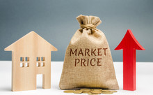 Money Bag With The Word Market Price And An Up Arrow With A Coins And Wooden House. The Concept Of Increasing Housing Prices. Rising Rent. Real Estate Market Growth