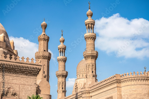 Vászonkép .View of the ancient minarets of the Cairo mosque Sultan Hassan on a sunny day