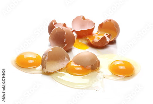 Broken eggs, eggshells with yolk isolated on white background