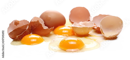 Broken eggs, eggshells with yolk isolated on white background