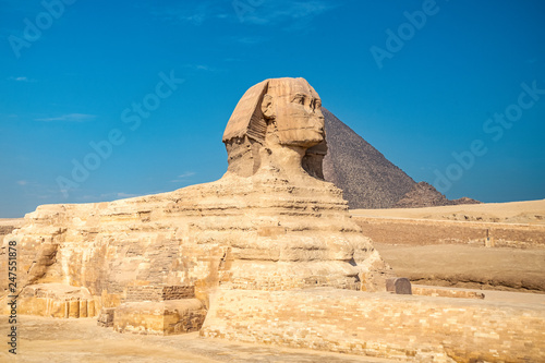 .Sphinx on blue sky background