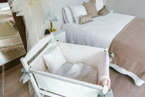 Bedroom with cot and double bed Canvas Print