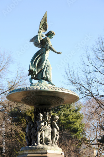"""A side view look in winter at the iconic and historic """"Angel of the Waters"""" statue in New York City's Central Park Canvas Print"""