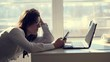 A young female clerk office worker browses social networks on a mobile phone, during her work day, in an office. a short break, rest in work. possible concept of unscrupulous and lazy employee or