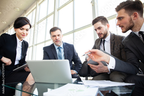Corporate business team meeting in a modern open plan office
