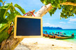 canvas print picture - Blank blackboard sign on tropical beach, add your text