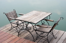 Wooden Table And Chairs Near Lake.