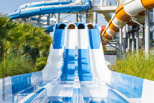 Foto  Adult water slides with pipes in water park.