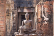Leinwanddruck Bild - Ancient Buddha in Phra Prang Sam Yod a former Hindu shrine built in the 13th century in the classic Bayon style of Khmer architecture.Thailand.