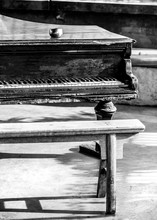 Old Piano With Bench In Foregr...