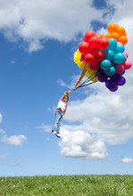 Little Girl Flying Away With Bunch Of Balloons