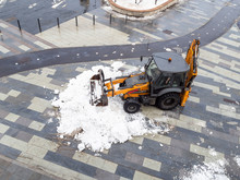 Snow Removal By Tractor From City Street
