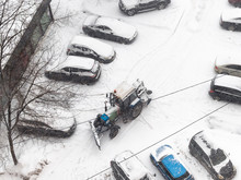 View Of Cleaning Of Parking Area With Tractor Snow