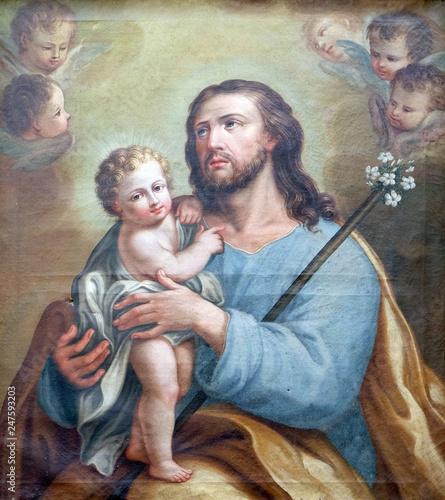 Fotografering Saint Joseph holding baby Jesus, altarpiece in San Petronio Basilica in Bologna,