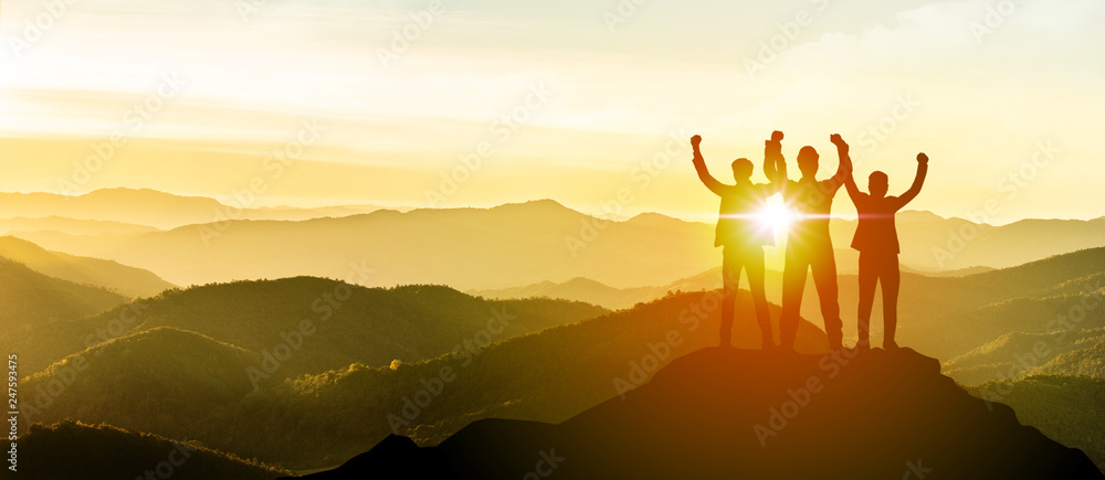 Fototapety, obrazy: Silhouette of Business team show arm up on top of the mountain. Leadership and success Concept.