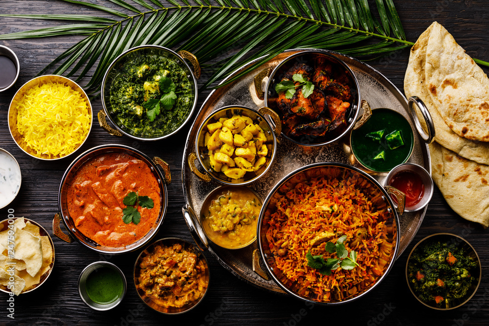 Fototapety, obrazy: Indian food Curry butter chicken, Palak Paneer, Chiken Tikka, Biryani, Vegetable Curry, Papad, Dal, Palak Sabji, Jira Alu, Rice with Saffron on dark background