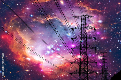 Photo  silhouette power electric pole and electric line colorful galaxy nebula sky
