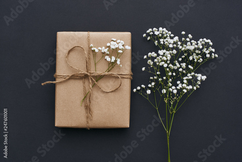 Making something special... Close-up image of beautiful gift box decorated with flowers