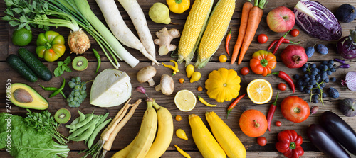 Poster Cuisine White, yellow, green, orange, red, purple fruits and vegetables on wooden background. Healthy food. Multicolored raw food.