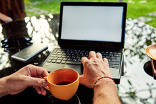 Freelancer Working On A Laptop...