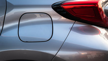 Close Up Of Car Petral Lid With Back Light On The Grey Metalic Shiny Car.