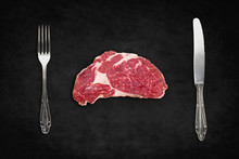 Raw Steak / Red Meat With Knife And Fork On Black Background -