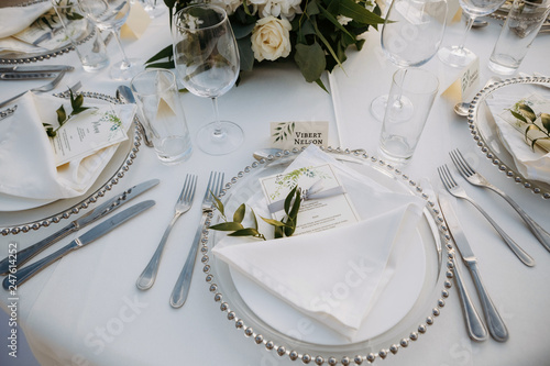 Fototapeta Classic white set of wedding dinner table. White bouquets as a centerpiece obraz
