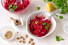 Healthy Raw Vegan Beetroot Salad With Carrot And Walnuts In A Bowl On White Wooden Table. Natural Organic Food Concept. Healthy Diet