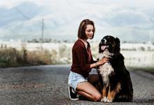 Woman Petting Her Dog
