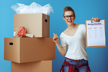 Happy Woman Near Cardboard Box...