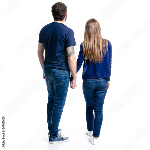 Fotografía Man and woman hold hands on white background isolation, back view