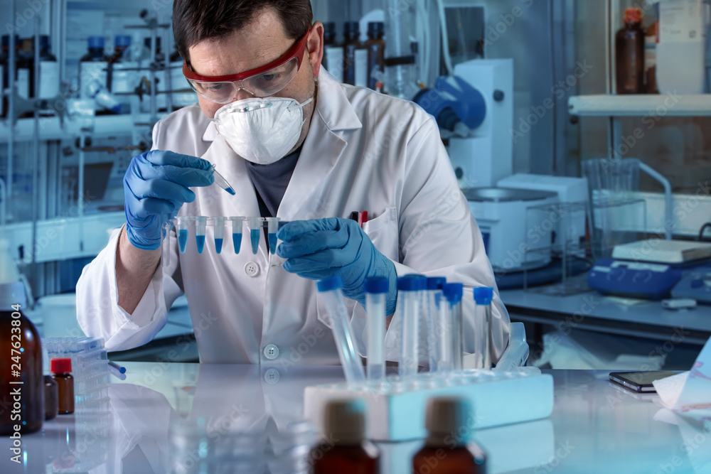 Fototapeta geneticist holding pcr tubes for genetic analytical in the clinical laboratory