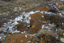 Aerial Top View Of A Large Pile Of Garbage. Pile Of Garbage On An Illegal Elemental Garbage Dump Or On Landfill, Many Household Waste Plastic Bags In Front Of House. Landfill, Environmental Waste