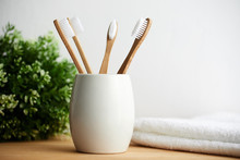 Four Bamboo Toothbrushes In A ...