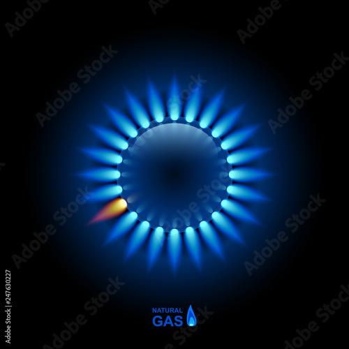 Fotografía Gas flame with blue reflection on dark backdrop