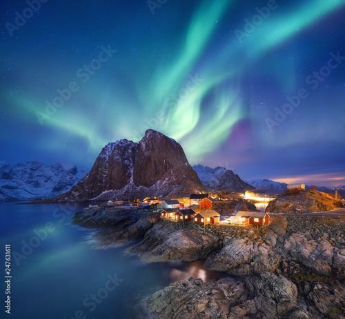 Poster Aurore polaire Aurora borealis on the Lofoten islands, Norway. Green northern lights above ocean. Night sky with polar lights. Night winter landscape with aurora and reflection on the water surface. Norway-image