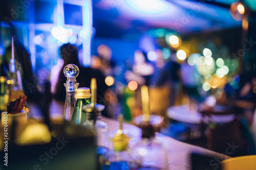 Alcoholic Cocktails and drinks and bottles at Bar counter in Night club. Night life concept image background.  - 247644804