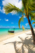 canvas print picture - Trou aux biches, Mauritius. Tropical exotic beach with palms trees and clear blue water.