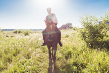 Young Man Riding A Horse In Th...